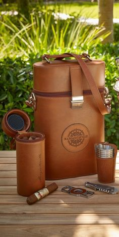 Perfect for your next picnic or day at the beach, this handsome, multipurpose carrying case features padded interior storage for two full-size wine bottles, plus a portable humidor that holds up to seven large cigars. | Margaritaville by Frontgate