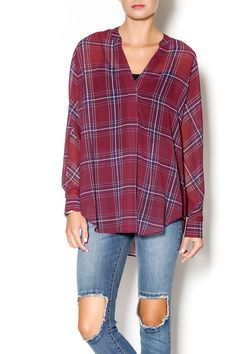Plaid is a must have this fall! This relaxed fit, chiffon like blouse has a v-neck with one hidden button. Slightly sheer. Wear with layering tank or bralette, jeans, and booties.   Plaid West Top by Gentle Fawn. Clothing - Tops - Long Sleeve Clothing - Tops - Blouses & Shirts Clothing - Tops - Casual Cincinnati, Ohio