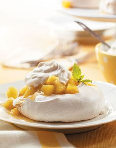 Light as a feather and just as light in calories, with Pavlova you can have your cake and eat it too! Pavlova, named for Russian ballerina Anna Pavlova, is a meringue-based dessert topped with fruit and whipped cream. Snack Recipes, Dessert Recipes, Snacks, Pavlova Toppings, Baked Meringue, Pineapple Sauce, Delicious Desserts, Yummy Food, Anna Pavlova