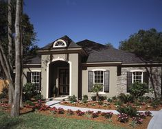 With arches and shutters, this elegant Mediterranean home is certainly one of our most requested house plans, with an area of 2,802 Sq. Ft. To see the actual floor plans for this home, click here: http://www.thehousedesigners.com/plan/5030/
