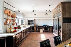 Ellen Pompeo's dream kitchen includes a La Cornue range, oven, and cabinetry and a Carrara-marble backsplash