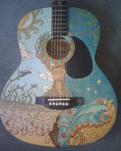 Charolett Salo – Guitar 02  This depicts the final image of the guitar. I have been waiting many years for the right item to use this tree holding the earth on.