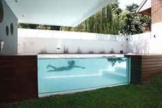 One of the nicest above ground swimming pools. Located in Argentina, this modern home by Andrés Remy Arquitectos features an elevated glass swimming pool design. The architects decided to raise the swimming pool because it would have otherwise been shaded by the home and surrounding fence.