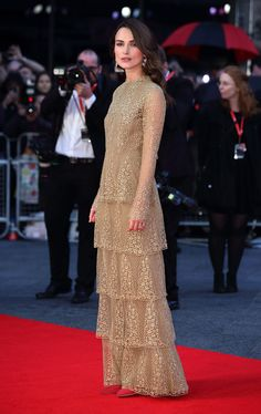 """Keira Knightley wore a Haute Couture Valentino long sleeved gown embroidered in threads of gold called """"The Golden Hour"""", from the Fall 2014 Couture collection on the red carpet at the BFI London Film Festival for the premier of 'The Imitation Game' ."""