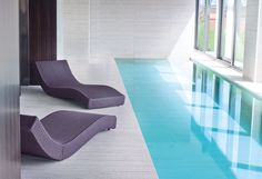 Minimalist indoor pool, loungers by Paola Lenti _ Pool. ideas, backyard, patio, diy, landscape, deck, party, garden, outdoor, house, swimming, water, beach.