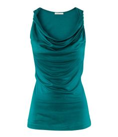 Top in jersey fabric with a sheen. Twisted shoulder straps and draping at top.