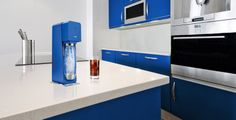 A beautiful kitchen with a blue #Source machine from #SodaStream