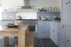 Hand painted Parma Gray cabinets, solid bespoke oak table | Beach Retreat