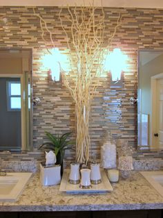 love the way this is styled.  Dried willow branches are great way to add height in the bath between the sinks and mirrors.