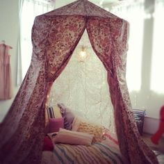 umbrella fort/tent...could even do this with an outdoor patio umbrella