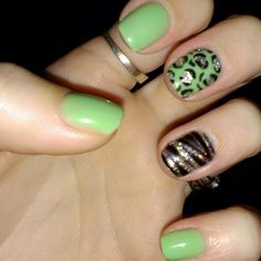 Black and lime green gel nail design with leopard print and silver glitter.