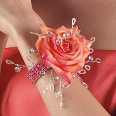 Corsage.  Bring out your inner Princess, floral jewelry is super hot this Prom Season!  We can replicate your favorite designs and match your corsage to your dress.  Find us at www.flowersofcharlotte.com