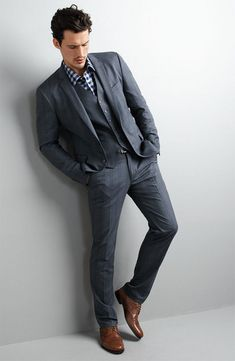 The suit jacket, vest and dress pant with bold shirt