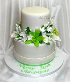 White and Green Floral Birthday Cake with stargazer lillies, orchids, calla lillies