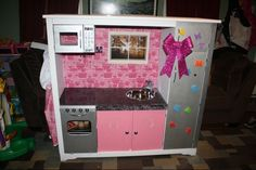 Repurposed entertainment center into play kitchen!  I think I'm goin to do this.