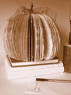 """Book page pumpkin <3--what is with people destroying books?? I don't want a pumpkin made from """"old books""""! I want old books made from old books!!"""