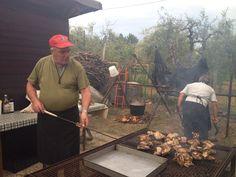 Preparing the pollo alla bracce! grilled chicken.