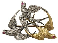 'Antique Swallow Brooch - Victorian' http://www.acsilver.co.uk/shop/pc/0-55-ct-Diamond-18-ct-White-Gold-and-18-ct-Yellow-Gold-Swallow-Brooch-Antique-Victorian-107p8947.htm