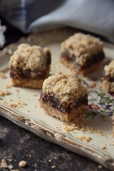 A timeless classic: Date Squares. Who can resist a date filling sandwiched between an oat crumble? #datesquares #shelovesbiscotti