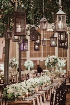 Lanterns are a big trend - here an assortment of styles add interest hanging over long tables ~ Brides