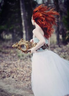 Red Head girl with magic mirror