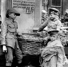 WWI, Germany; Children collecting potato peels as fodder for livestock. -Ullstein Bild/Getty Images