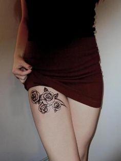 I love this tattoo placement... I would just change the roses to another kind of flower...