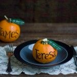 Mini pumpkins with names for seating at a party or wedding.
