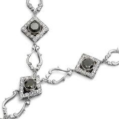 A close up of our Necklace.   White gold with #diamonds and #blackdiamonds