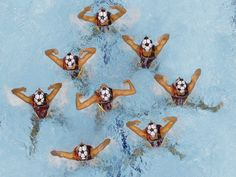 Team Canada swims synchro. Soccer anyone?