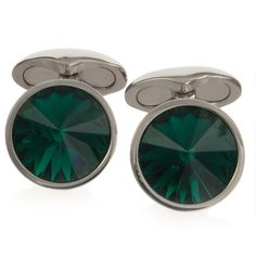 Emerald Swarovski Galileo Cufflinks by Babette Wasserman - These luxurious emerald cufflinks feature hand carved Swarovski crystals mounted on rhodium plated backs. The facets in the stone catch the light brilliantly.     Measuring 1.5cm in diameter; they look striking on white shirt.