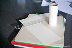 Wrap toilet paper roll with white paper