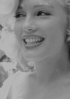 Marilyn at Rockefeller Center, NYC, for the soon to be built Time-Life Building ceremonies, July 2, 1957.
