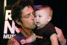 Chris Cornell gives his baby daughter Toni a kiss