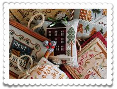 Pile of LHN ornaments from Little House Needleworks' blog--with Vonna's amazing finishing--swoon!