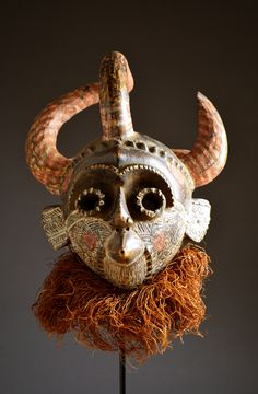 Africa | Mask from the Pende people of DR Congo | Wood, raffia, fiber, paint and pigment | Mid 20th century