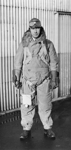 ROYAL AIR FORCE INTERWAR PERIOD (Q 68560)   An RAF pilot's flying suit, showing parachute harness and note-pad with watch strapped to pilot's thigh. Circa early 1920s. Pilot's name might be M. V. McCudden, photograph taken at Farnsborough.