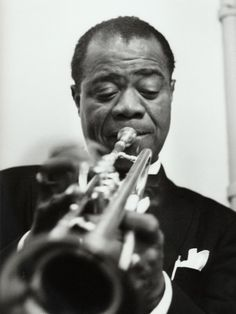 "Music Song: Louis Armstrong an American jazz trumpeter of the 1920's. His most famous song was ""What a Wonderful World"" released in 1967."