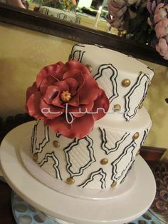 """""""Tacky"""" Cake - White fondant covered with embossed plaque cutouts, outlined in black icing, with gilded chocolate """"tacks"""" and a huge sugar rose. And it tasted as good as it looked, Cinnamon cake filled with Vanilla Bean Buttercream and Vanilla Roasted Pears. Yum! Yum!  Thanks for Looking!"""