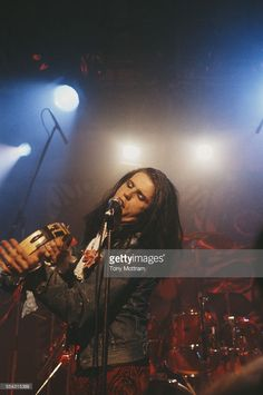 Singer Ian Astbury performing with English rock group The Cult, 1985.