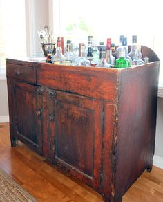 Furniture Inspiration. Sterling Liquor Cabinet Classic And Contemporary Design: Antique Distressed Wooden Liquor Cabinet For Whiskey Storage With Enclosed Double Doors And Drawers On Wood Floors Panels In Open Views Living Areas Furnishing Decors