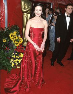 In 1999, Catherine Zeta-Jones looked red hot in this strapless Versace gown. [Photo: Getty Images]