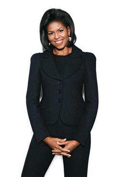 Michelle Obama in basic classic black pant suit. First Lady believes every woman is a Diva