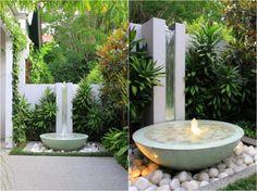fontaine de jardin décorée de galet if blanc et bel éclairage