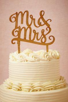 BHLDN   http://www.bhldn.com/product/mr-mrs-cake-topper/