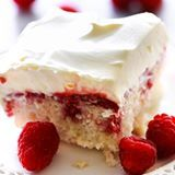 This Raspberry Poke Cake is so simple and such a wonderful dessert! It has a wonderful berry filling infused into each bite of cake that is both tart and sweet. (Direct link in profile) #chefintraining #chefintrainingblog #cake #huffposttaste