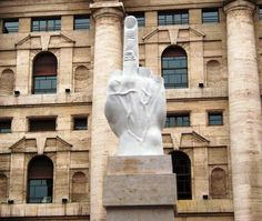 There is a giant middle finger statue in front of Milan Stock Exchange building. The 11-meter high statue known as The Middle Finger is created by the Italian contemporary artist Maurizio Cattelan.