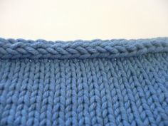 I-cord, worked on the bind off row, makes a decorative edging that is firm and has a nicely finished appearance