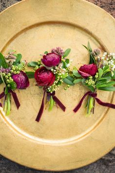 Comments from Studio Emme:  Ranunculus come in all sorts of bold colors and are great in boutonnieres.  The touch of velvet ribbon adds to the richness of this look.  Budget $$ // Photography:  Shelley Elena Photography - shelleyelenaphotography.com