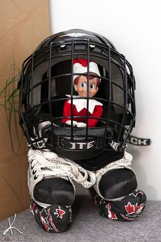 Wearing a helmet and skates. #elfontheshelf